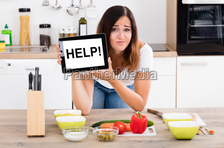 woman holding digital tablet showing help