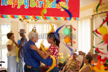 people enjoy birthday party with friends
