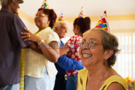 senior friends dancing at birthday party