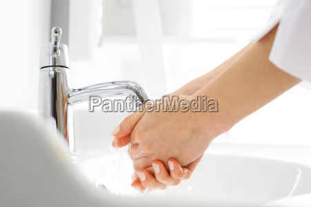 the doctor washes his hands surgeon