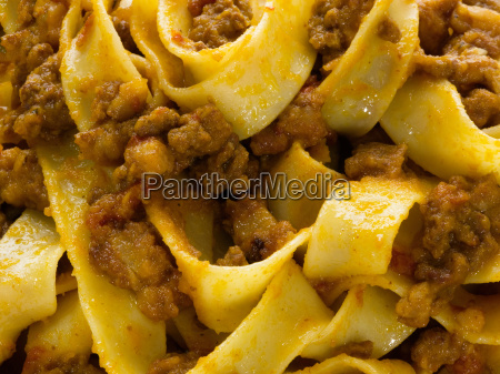 rustic traditional italian pappardelle bolognese