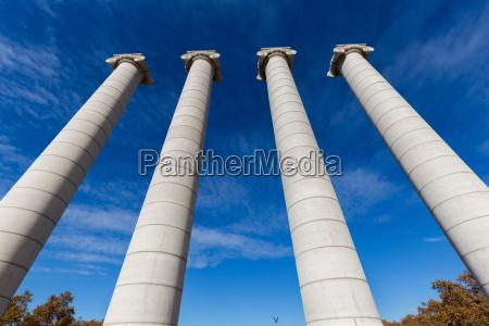 four massive columns blue sky in