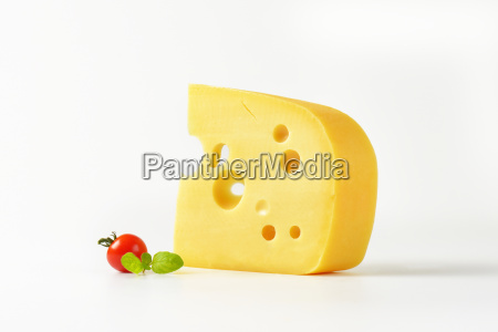 wedge of yellow cheese with eyes