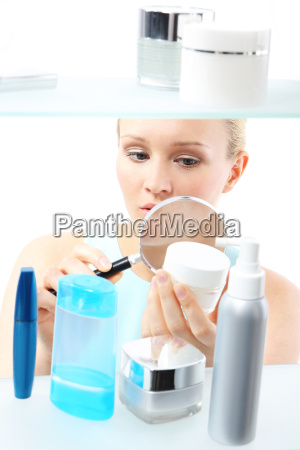 cosmetic shopping woman reading labels