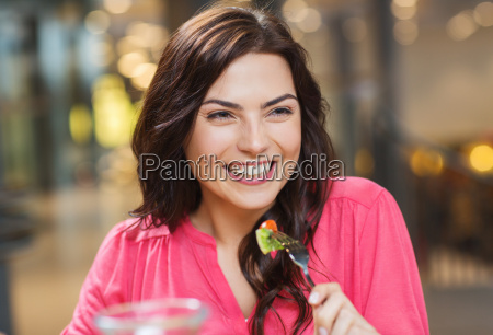 happy young woman having dinner at