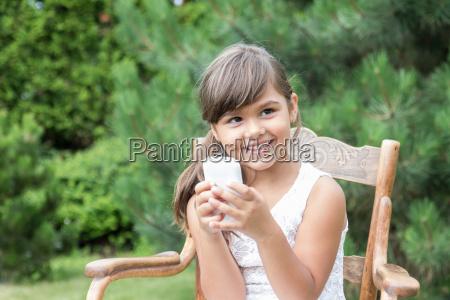 smiling brunette little girl with smart