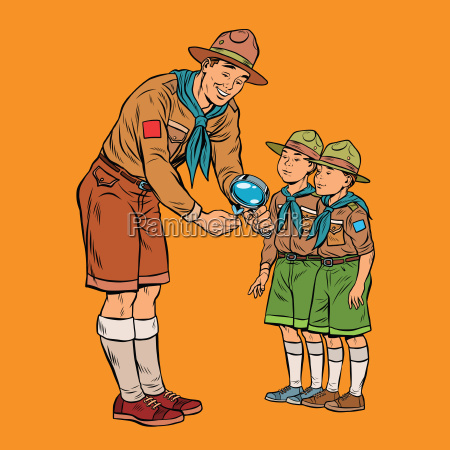 scoutmaster shows little insect to young