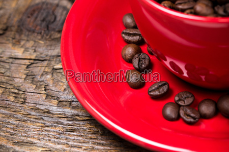 coffee beans in red cup closeup