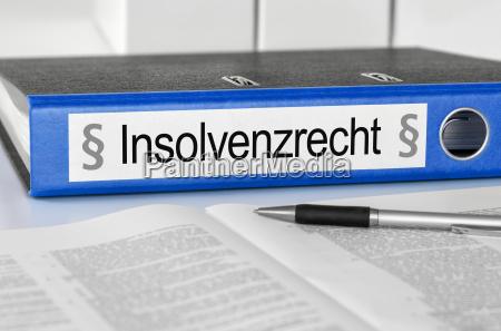 aktenordner mit der beschriftung insolvenzrecht
