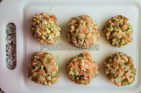 raw meatballs of salmon and celery
