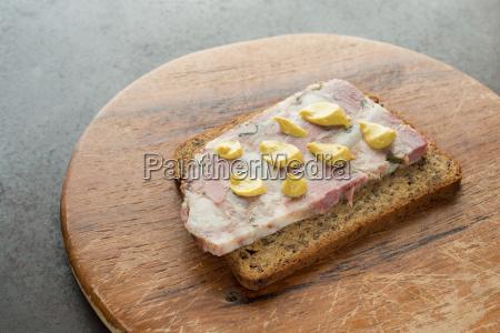 slice of wholemeal bread with soppressata