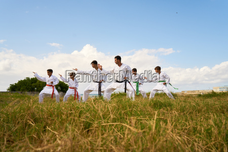 karate school with trainers and boys