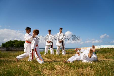 school teachers and children at karate