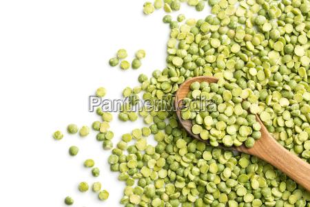 green split peas in wooden spoon