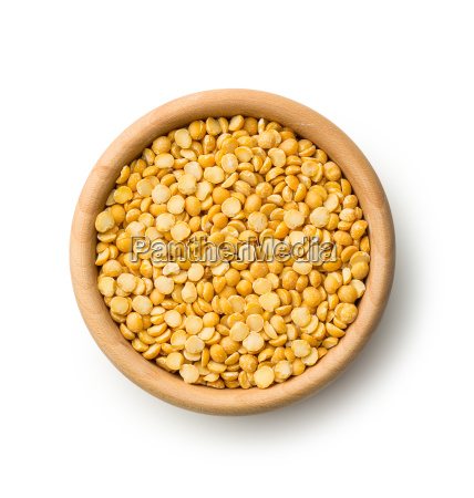 yellow split peas in wooden bowl