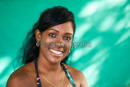 happy latina girl young black woman