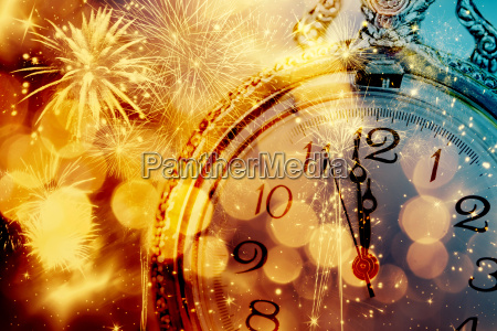 abstract background with fireworks and clock