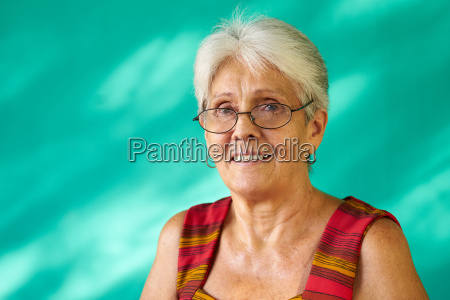people portrait happy elderly hispanic woman
