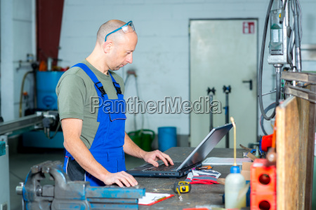 worker in factory on work bench