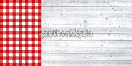light wooden boards with tablecloth red