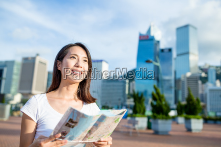 woman using city map in hong