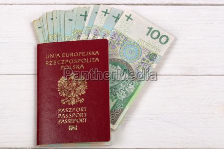 polish passport with polish currency