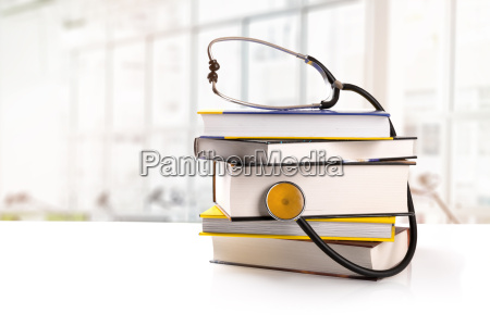 medical education stack of books