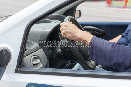 learner driver driving car with instructor