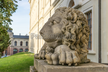 sculpture of a lion in front
