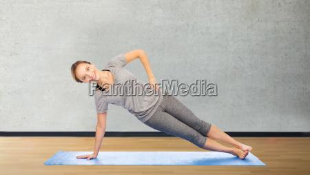 woman making yoga in side plank