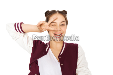 happy smiling teenage girl showing peace