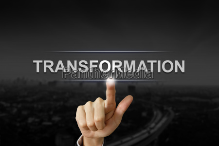 business hand pushing transformation button on