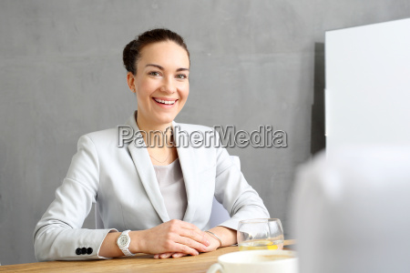 businesswoman female office worker sitting at
