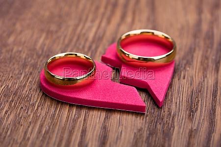 golden ring on red broken heart