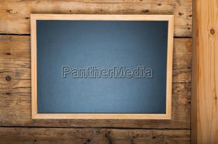blackboard on wooden wall