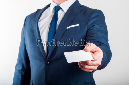 businessman in suit is showing business