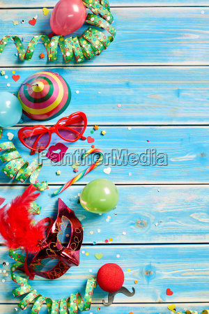 streamers and party favors on wooden