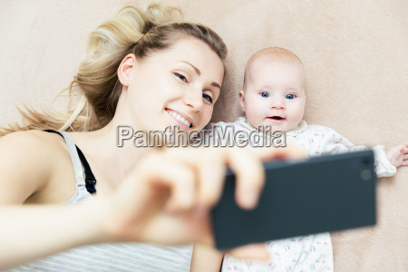 mother and little infant baby taking