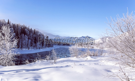 winter snowy landscape by a river