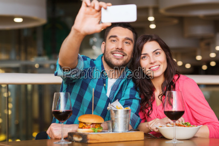 couple taking selfie by smartphone at