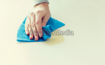 close up of hand cleaning table