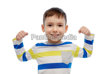 happy smiling little boy with raised