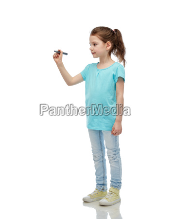 little girl drawing or writing with
