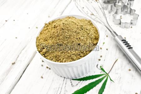 flour hemp in bowl on light