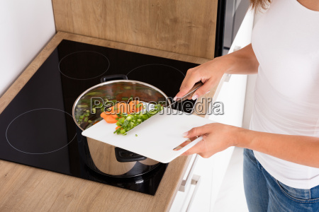 close up of woman cooking food
