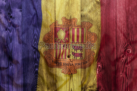national flag of andorra wooden background