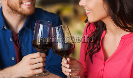happy couple dining and drink wine