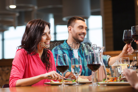 friends clinking glasses of wine at