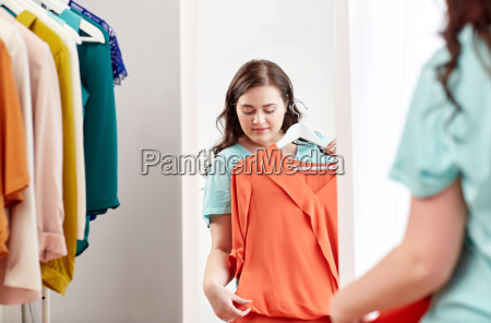 happy plus size woman with shirt