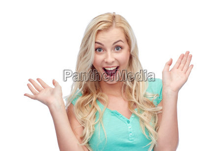 surprised smiling young woman or teenage